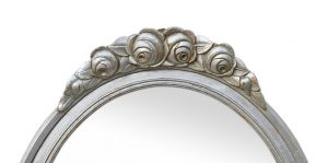 Art-Deco-oval-mirror-with-flowered-decor-carved-wood-pediment